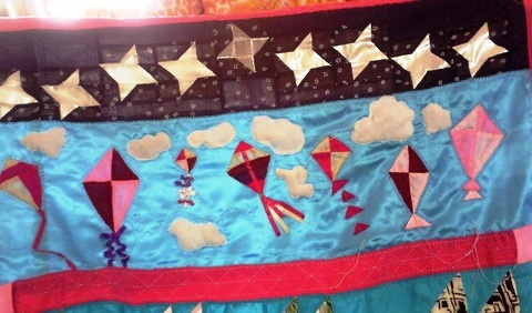 My favourite part of the quilt. Each kite has a different `tail'. The white chiffon clouds are stuffed with polyfibre