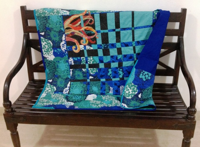 Convergence Quilt with appliqued octopus