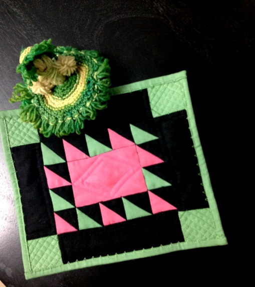 Amish style miniature quilt