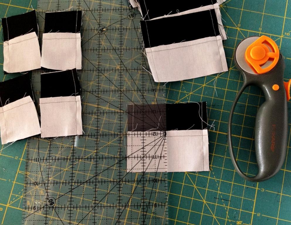 Cut along the centre line of each piece