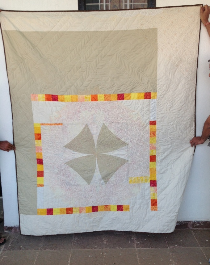 Quilt pieced back with giant winding ways block
