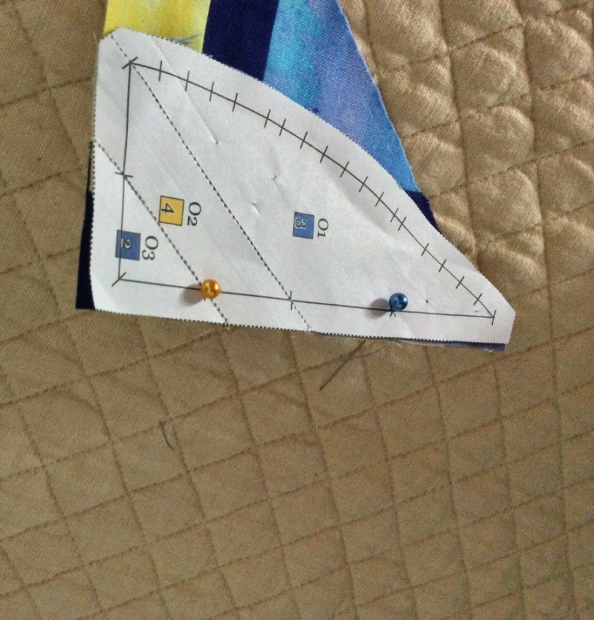 'Vertical' pin pushed through marker before securing the templates