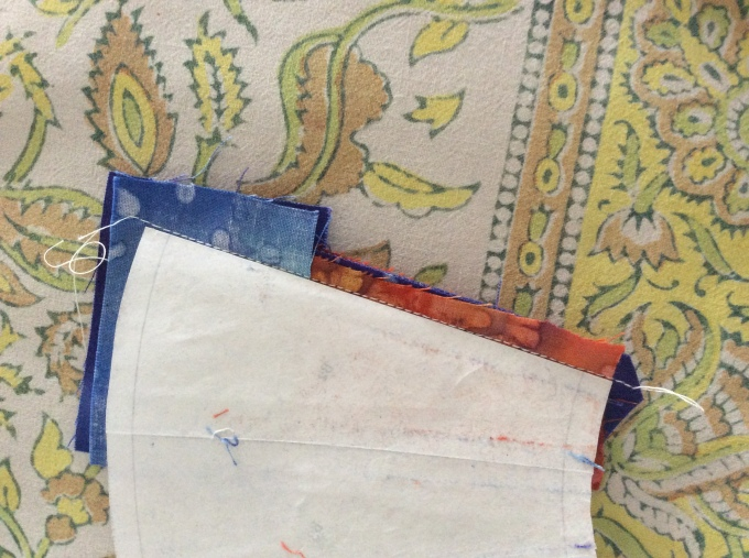 """sew in 1/4"""" seam allowance visible beyond folded freezer paper template."""