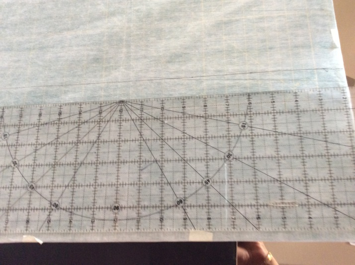 Using the inch grid as a guide, start drawing lines on the sheet with a perma-pen.