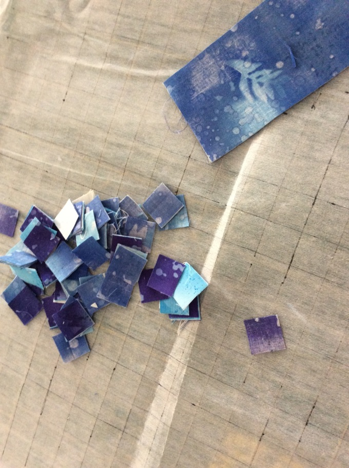 """I cut 1"""" squares from the fabric, except a 3"""" x 6"""" strip."""