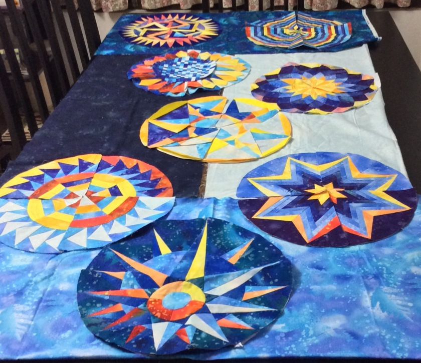 The first eight blocks of the Dusk Round the Year Quilt