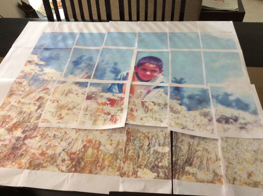 The print out of the enlarged image laid out on the table.