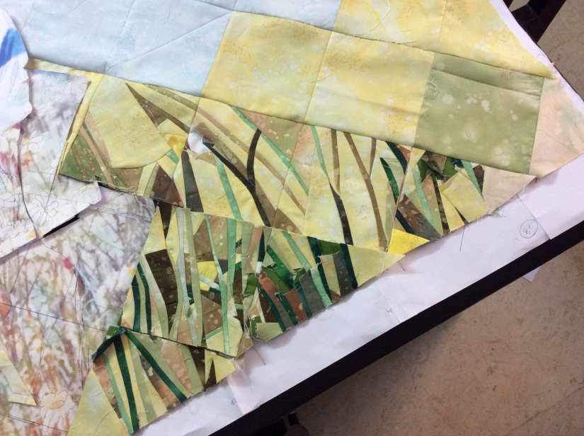 The `distant' flower covered hills in yellow. The details would be brought out by the quilting