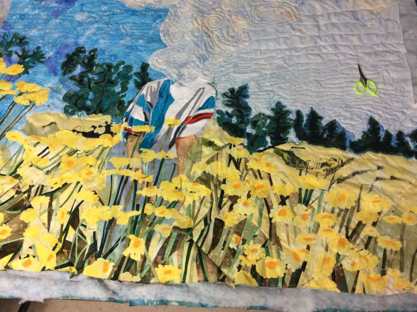 Burying the threads took a full day as I used 3 blues, 5  greens and 4  yellows for the quilting.