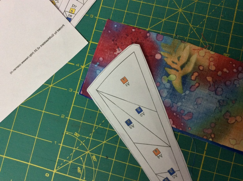 Align the edges of strips for A1 (Fabric#4 and Fabric #2) and place the template A ready for the first seam.