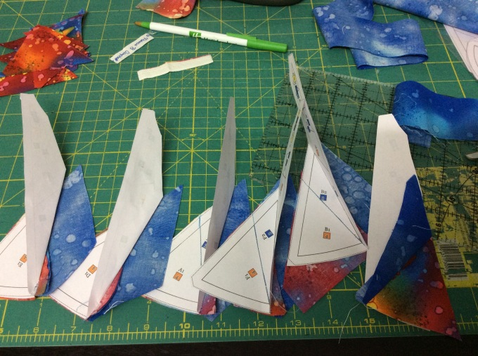 Now fold the paper template at seam line between piece#2 and piece#3. Trim the fabric (Strip#2) 1/4