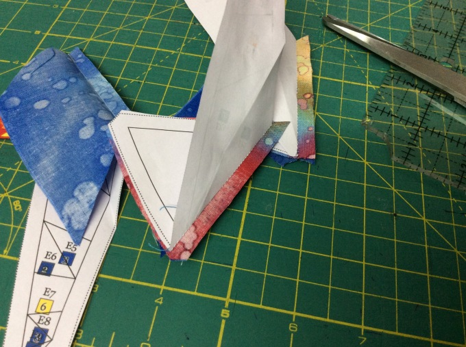 Fold back the paper template on seam line and trim the seam to 1/4